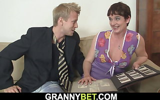 Hairy grey pussy granny in stockings rides his cock