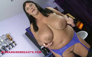 Mature Carol Brown's amazing tits increased by ass