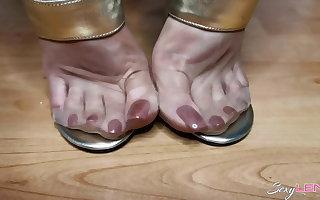 Nylon Feet And Blond Sandals
