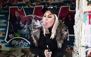 Blonde Lady Smokes An Electric Cigarette On Inappropriate to