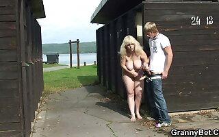 Big tits blonde grandma rides stranger's cock on public